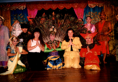 Kelly, in yellow, participating in a Malaysian cultural night